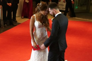 Argentine soccer player Lionel Messi and his wife Antonela Roccuzzo pose at their wedding in Rosario