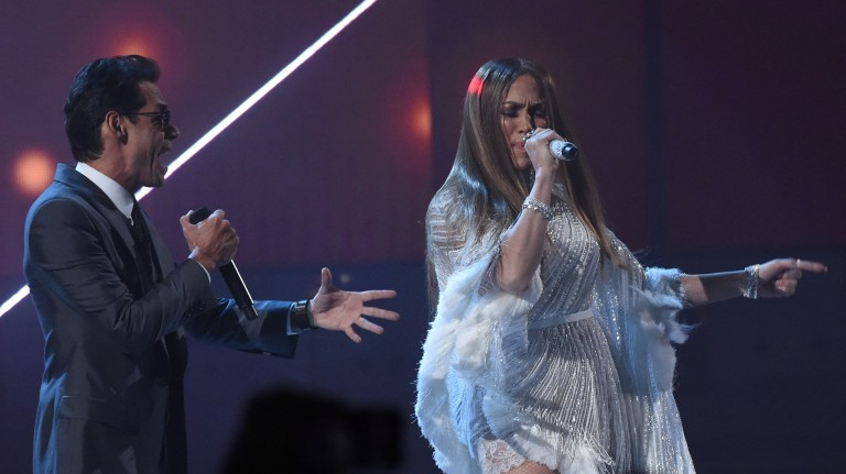 (FILES) This file photo taken on November 17, 2016 shows singer Marc Anthony performing with Jennifer Lopez during the show of the 17th Annual Latin Grammy Awards in Las Vegas, Nevada.  Their marriage