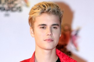 FILE - In this Nov. 7, 2015 file photo, Justin Bieber arrives at the Cannes festival palace in Cannes, southeastern France. Police say Bieber has accidentally struck a photographer with his pickup truck Wednesday night in Beverly Hills. (AP Photo/Lionel Cironneau, File) ORG XMIT: BKWS114