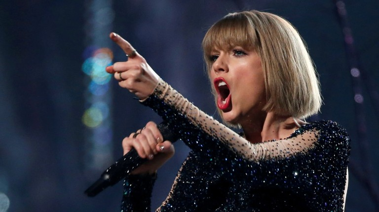 "FILE PHOTO: Taylor Swift performs ""Out of the Woods"" at the 58th Grammy Awards in Los Angeles"