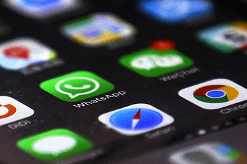 WhatsApp is seen with other mobile apps on a smartphone in Beijing, Tuesday, July 18, 2017. Users of WhatsApp in China and security researchers reported Tuesday widespread service disruptions amid fears that the popular messaging service may be at least partially blocked by authorities in the world's most populous country. The app was partly inaccessible unless virtual private network software was used to circumvent China's censorship apparatus, known colloquially as The Great Firewall. (AP Photo/Andy Wong) ORG XMIT: XAW107