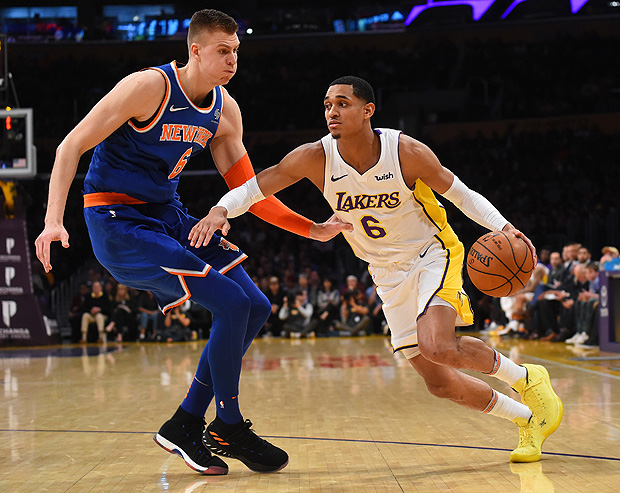 Jan 21, 2018; Los Angeles, CA, USA; New York Knicks forward Kristaps Porzingis (6) defends Los Angeles Lakers guard Jordan Clarkson (6) in the second half at Staples Center. Mandatory Credit: Jayne Kamin-Oncea-USA TODAY Sports ORG XMIT: USATSI-362903