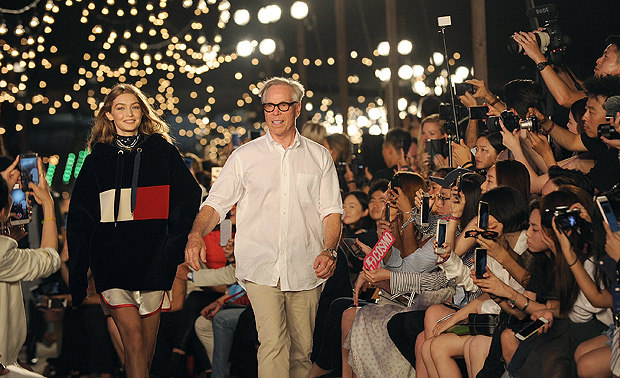 Gigi Hadid and Tommy Hilfiger walk the runway after the Tommy Hilfiger Fall 2016 collection and the TommyXGigi capsule were shown at Fashion Week in New York, Friday, Sept. 9, 2016. (AP Photo/Diane Bondareff) ORG XMIT: NYDB118