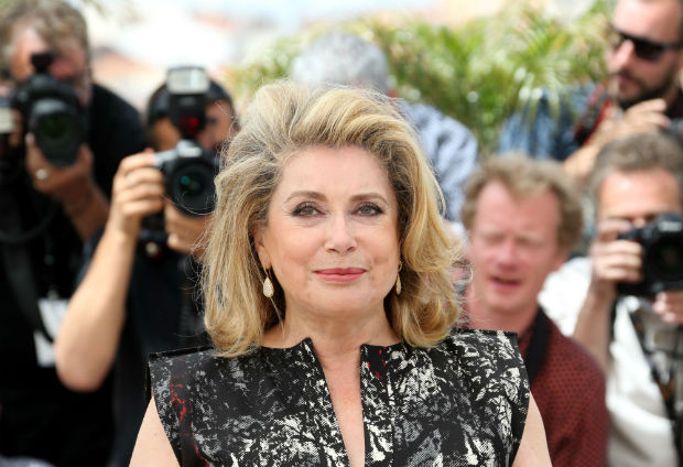 "(FILES) - A file picture taken on May 21, 2014 at the 67th edition of the Cannes Film Festival in Cannes shows French actress Catherine Deneuve posing during a photocall. Deneuve, who plays in the movie ""La Tête haute"" (""Heads Up"") which opens the 68th edition of the Cannes Film Festival on May 13, told in an AFP interview on May 10, 2015 that she ""hates the selfie pictures"" and that with the numeric technology ""there are no stars anymore in France"". AFP PHOTO / LOIC VENANCE ORG XMIT: CAN5882"