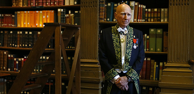 Photographer Sebastiao Salgado poses as he was elected in the French Academy of Fine Arts (Academie des Beaux-Arts) during a ceremony in Paris, France, Wednesday, Dec. 6, 2017. The Academy of Fine Arts concerning Paintings, Sculpture Music, Architecture and Photography is part of the French Academy, concerning the French language, the Academy of Humanities, the French Academy of Sciences and the Academy of Moral and Political Sciences. (AP Photo/Francois Mori) ORG XMIT: ZFM109