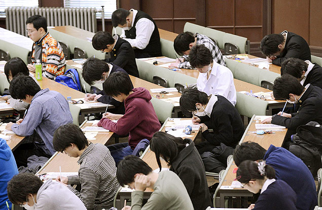 In this January 2013 photo, preparatory students sit for National Center Test for University Admissions at the University of Tokyo. Students from Shanghai, Hong Kong, Singapore, Taiwan, Japan and South Korea were among the highest-ranking groups in math, science and reading in test results released Tuesday, Dec. 3, 2013 by the Program for International Student Assessment (PISA) coordinated by the Paris-based Organization for Economic Cooperation and Development (OECD). The group tests students worldwide every three years. In Japan, the government added 1,200 pages to elementary school textbooks after its children fell behind in those in rivals such as South Korea and Hong Kong in 2009, although Japan's scores for 2009 were tops for rich industrialized countries. Japan has since improved its standings in all three areas. (AP Photo/Kyodo News) JAPAN OUT, CREDIT MANDATORY ORG XMIT: TOK403