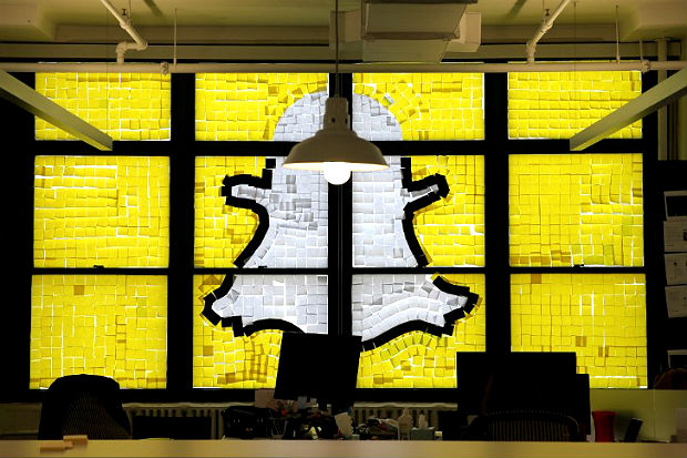 "Snapchat logo image created with Post-it notes is seen in the windows of Havas Worldwide offices at 200 Hudson street in lower Manhattan, New York during ""Post-it note war""An image of the Snapchat logo created with Post-it notes is seen in the windows of Havas Worldwide at 200 Hudson Street in lower Manhattan, New York, U.S., May 18, 2016, where advertising agencies and other companies have started what is being called a ""Post-it note war"" with employees creating colorful images in their windows with Post-it notes. REUTERS/Mike Segar"