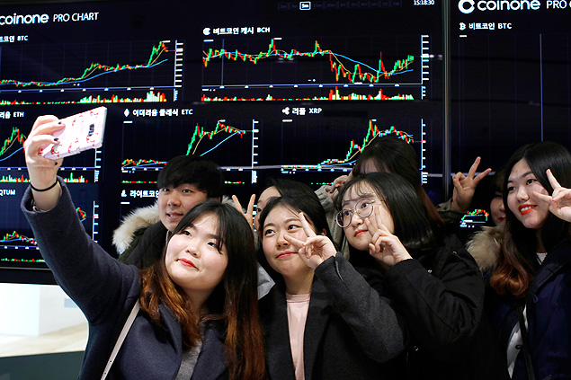 Students of Konyang University visit Coinone, a virtual currency exchange office in Seoul, South Korea, Nov. 28, 2017. Around the world, ordinary people with no prior experience in virtual currencies have been lured into the markets by soaring prices, but nowhere has the public frenzy been more feverish than in South Korea. (Woohae Cho/The New York Times)