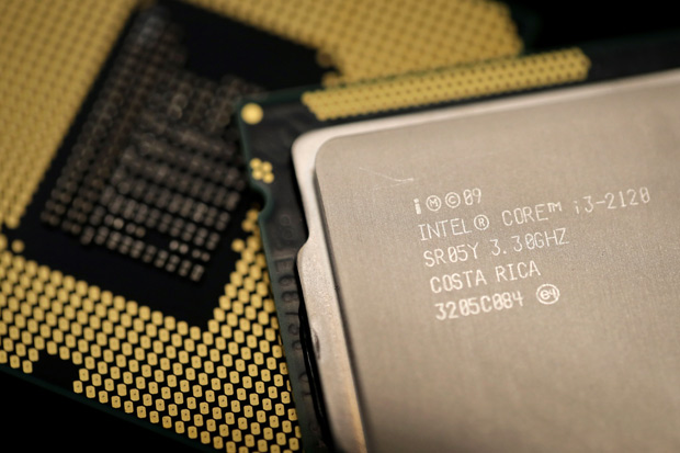 """Computer processors by US technology company Intel are pictured on January 5, 2018 in Paris. As tech giants race against the clock to fix major security flaws in microprocessors, many users are wondering what lurks behind unsettling names like """"Spectre"""" or """"Meltdown"""" and what can be done about this latest IT scare. / AFP PHOTO / Thomas SAMSON"""