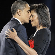 President-elect Barack Obama, left, kisses his wife Michelle Obama after addressing supporters at the election night rally in Chicago, Tuesday, Nov. 4, 2008. (AP Photo/Jae C. Hong)