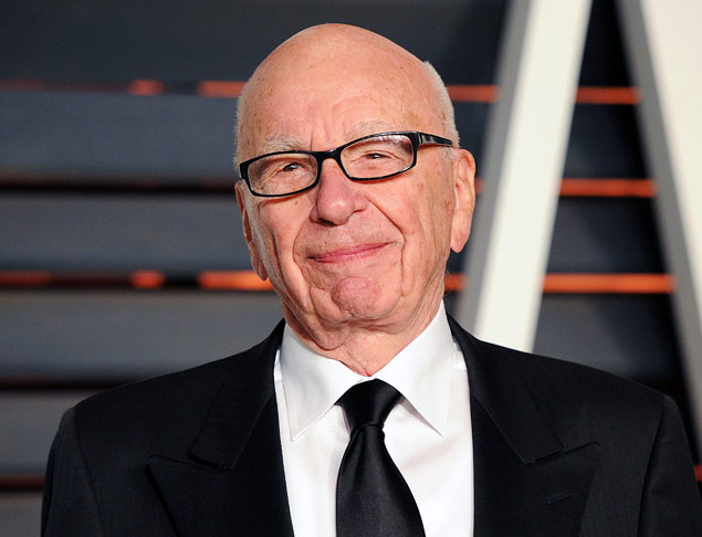"""FILE - In this Feb. 22, 2015 file photo, Rupert Murdoch arrives at the 2015 Vanity Fair Oscar Party in Beverly Hills, Calif. Murdoch, issued an apology Thursday, Oct. 8, after he faced social media backlash following his suggestion that President Barack Obama isn't a """"real black president."""" (Photo by Evan Agostini/Invision/AP, FIle) ORG XMIT: NYET403"""