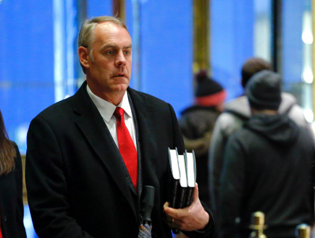 US Representative at large from Montana, Ryan Zinke (L) arrives at Trump Tower on December 12, 2016 in New York. / AFP PHOTO / KENA BETANCUR ORG XMIT: KB00