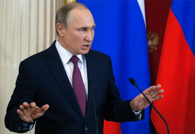 Russian President Vladimir Putin gestures as he speaks during a joint press conference with his Moldovan counterpart following their meeting at the Kremlin in Moscow on January 17, 2017.