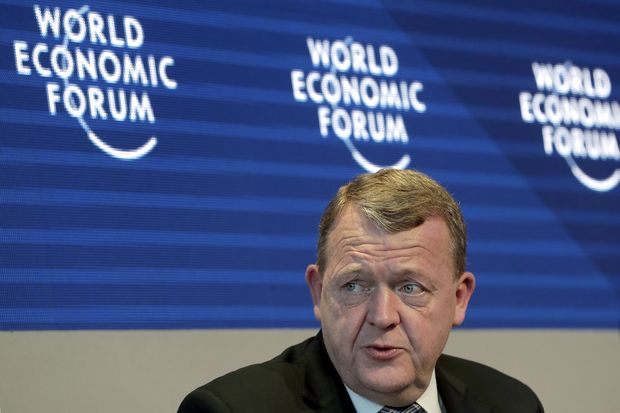 The Prime Minister of Denmark, Lars Lokke Rasmussen, speaks during a discussion as part of the annual meeting of the World Economic Forum in Davos, Switzerland, Friday, Jan. 26, 2018. (AP Photo/Markus Schreiber) ORG XMIT: RSOB102