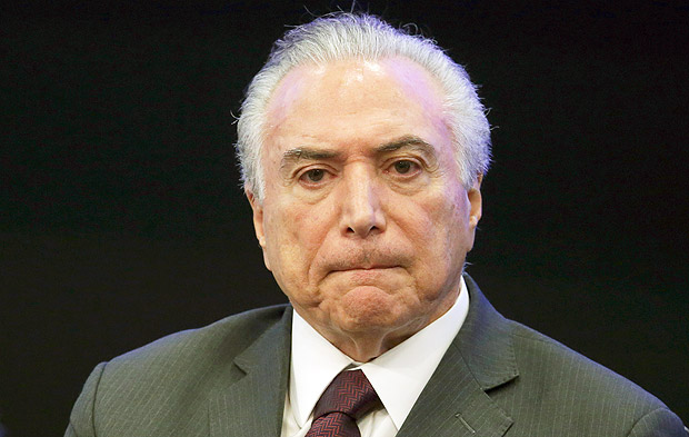 FILE - In this May 8, 2017, file photo, Brazil's President Michel Temer listens in during a event at the Brazilian Institute of Research in Brasilia, Brazil. Temer is denying a report that he endorsed the alleged bribing of a jailed former congressman to keep him quiet. The allegation made in a Globo News report on Wednesday, May 17, represents a potentially significant blow to President Temer. His administration has lurched from one crisis to another since he took office just over a year ago. (AP Photo/Eraldo Peres, File) ORG XMIT: XLAT102