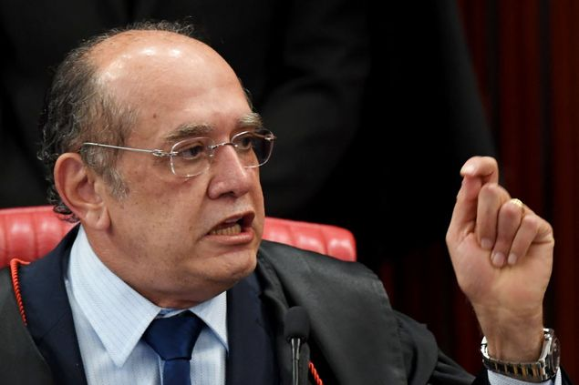 Supreme Electoral Court (TSE) President Gilmar Mendes speaks during the session examining whether the 2014 reelection of president Dilma Rousseff and her then vice president Michel Temer should be invalidated because of corrupt campaign funding, in Brasilia, on June 9, 2017. The lead judge looking into corruption during Brazil's 2014 presidential election voted Friday to strip President Michel Temer of his mandate, but the overall result remained unclear, with six judges yet to weigh in