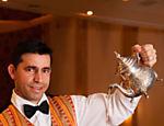 Serviço de chá e doces tradicionais do restaurante Arabia, vencedor Árabe na opinião do júri <a href=