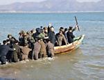 Em foto sem data divulgada pela agência de notícias oficial da Coreia do Norte no dia 11 de março, Kim Jong-un deixa o Destacamento de Defesa de Wolnae Islet após inspeção