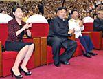 Ditador Kim Jong-un e sua mulher durante comemorações do que o regime diz ser uma