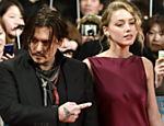 Johnny Depp e Amber Heard chegam para pré-estreia de
