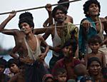 Imigrantes Rohingya esperam por ajuda em águas tailandesas <a href=