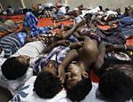 Imigrantes dormem em abrigo temporário em Langsa, na Indonésia