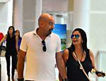 Gretchen embarca com o marido no aeroporto Santos Dumont no Rio de Janeiro