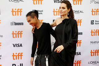 Jolie arrives with her sons Maddox on the red carpet for the film
