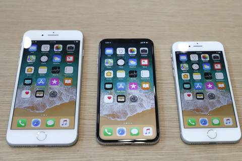 (L-R) iPhone 8 Plus, iPhone X and iPhone 8 models are displayed during an Apple launch event in Cupertino, California, U.S. September 12, 2017. REUTERS/Stephen Lam