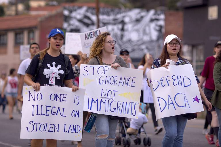 LOS ANGELES, CA - SEPTEMBER 10: Thousands of immigrants and supporters join the Defend DACA March to oppose the President Trump order to end DACA on September 10, 2017 in Los Angeles, California. The Obama-era Deferred Action for Childhood Arrivals program provides undocumented people who arrived to the US as children temporary legal immigration status for protection from deportation to a country many have not known, and a work permit for a renewable two-year period. The order exposes about 800,000 so-called �dreamers� who signed up for DACA to deportation. About a quarter of them live in California. Congress has the option to replace the policy with legislation before DACA expires on March 5, 2018. David McNew/Getty Images/AFP