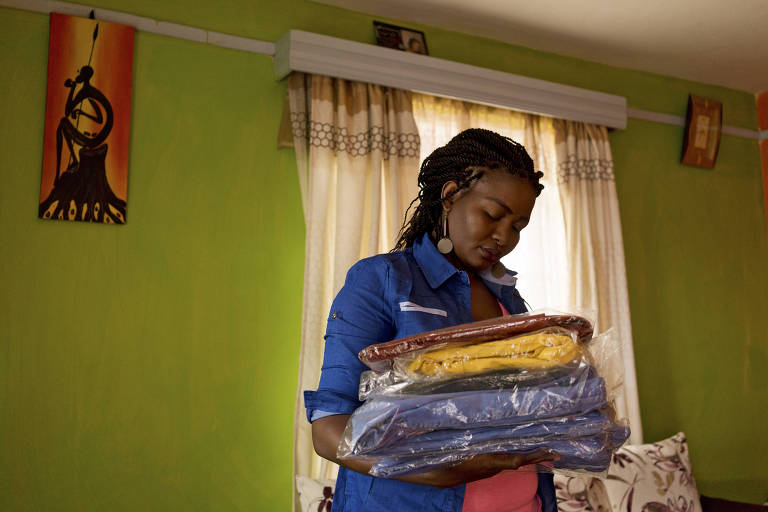 Phyl Cherop with plastic-wrapped items that she sells on Facebook, at her home in Nairobi, Kenya, March 22, 2017. Facebook and other tech companies are increasingly forced to navigate a web that is not as open as it once was, with nation-states exerting their power over the internet. (Adriane Ohanesian/The New York Times) ORG XMIT: XNYT70