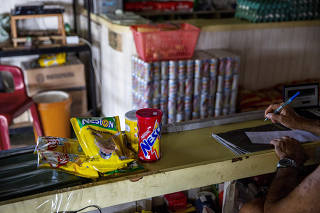Ana Cláudia Caranha buys a week?s worth of groceries, including many Nestlé products, at a grocery on the Amazon in Muana, Brazil.