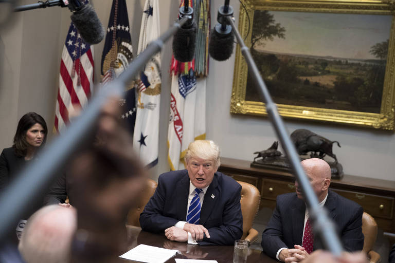 President Donald Trump hosts lawmakers on the House Ways and Means Committee, at the White House in Washington, Sept. 26, 2017. A day after Gov. Ricardo Rosselló warned that Puerto Rico was on the brink of a humanitarian crisis in the aftermath of Hurricane Maria, Trump announced that he would visit the island, a United States commonwealth, next week. (Tom Brenner/The New York Times) ORG XMIT: XNYT23
