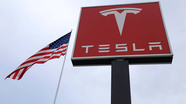 In this March 31, 2016, file photo, Tesla Motors unveils the new lower-priced Model 3 sedan at the Tesla Motors design studio in Hawthorne, Calif. Electric car maker Tesla said on Monday, July 3, 2017, that its Model 3 car will go on sale on Friday. (AP Photo/Justin Pritchard, File) ORG XMIT: BKCD202