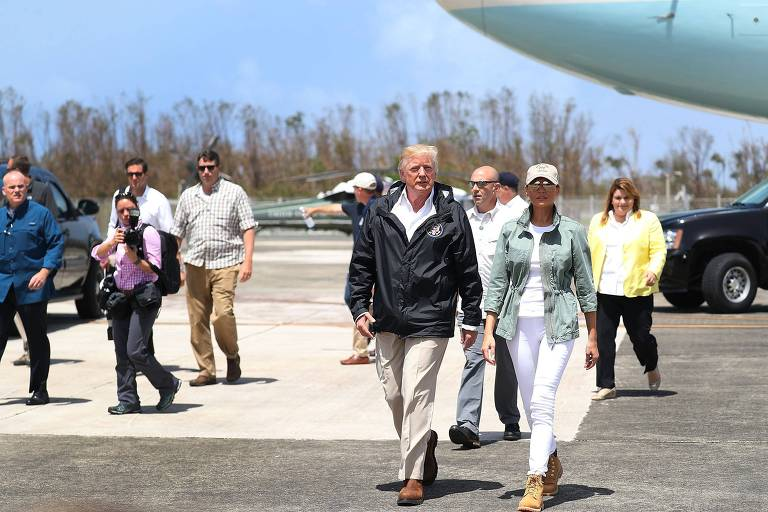 President Donald Trump and Melania Trump arrive on Air Force One at the Muniz Air National Guard Base for a visit after Hurricane Maria hit the island on October 3, 2017 in Carolina, Puerto Rico. The President has been criticized by some that say the government's response has been inadequate. Joe Raedle/Getty Images/AFP == FOR NEWSPAPERS, INTERNET, TELCOS & TELEVISION USE ONLY ==