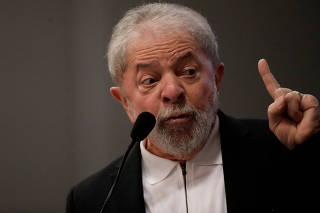 Former Brazil's President Luiz Inacio Lula da Silva gestures during a seminar on public education in Brasilia
