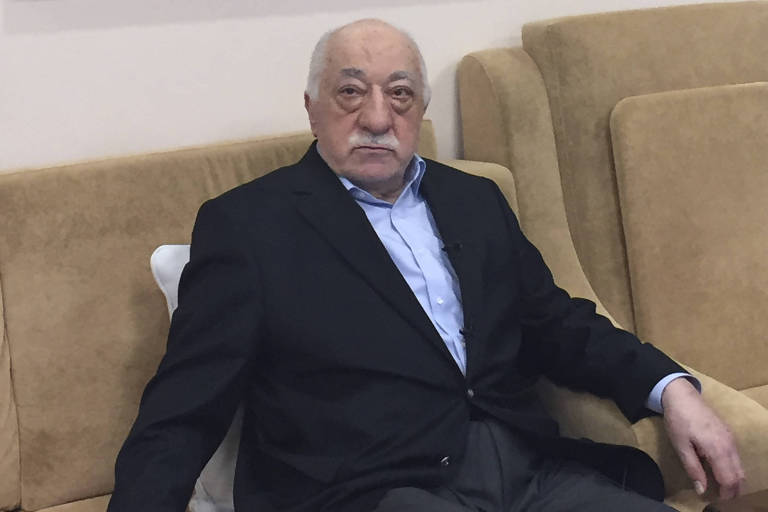 This file photo taken on July 18, 2016 shows Turkish cleric and opponent to the Erdogan regime Fethullah Gulen sitting at his residence in Saylorsburg, Pennsylvania. Turkey has asked the German authorities to formally investigate reported sightings in Germany of a top suspect in last year's failed coup who still remains at large. Ankara blames the doomed bid on July 15, 2016, to oust President Recep Tayyip Erdogan on the US-based Islamic preacher Fethullah Gulen, and has implemented a ruthless crackdown on his suspected supporters. / AFP PHOTO / Thomas URBAIN
