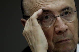 Brazilian Finance Minister Henrique Meirelles gestures during a news conference in Brasilia