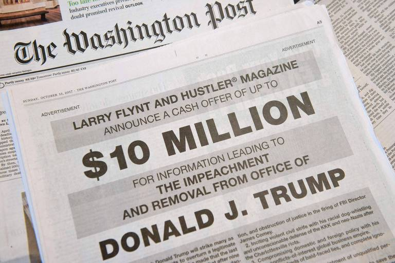"""A photo taken on October 15, 2015 in in Washington, DC shows a full-page newspaper advertisement in the Washington Post offering 10 million dollars from Hustler Magazine publisher Larry Flynt for information leading to the impeachment and removal from office of US President Donald Trump. """"I do not expect any of Trump's billionaire cronies to rat him out, but I am confident that there are many people in the know for whom $10 million is a lot of money,"""" Flynt said in the ad. The porn magazine founder noted that he had used million dollar cash rewards before to elicit information that helped upend the careers of two Republican politicians. / AFP PHOTO / SAUL LOEB ORG XMIT: SAL047"""