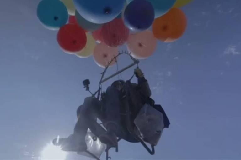 Tom Morgan, de 28 anos, alcançou 2,4 mil metros de altura sentado em uma cadeira de praia.