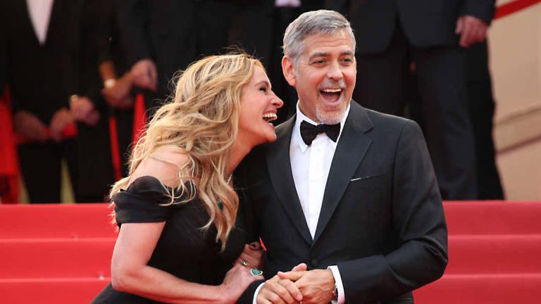George Clooney e Julia Roberts durante a estreia de 'Jogo do Dinheiro', em 2016