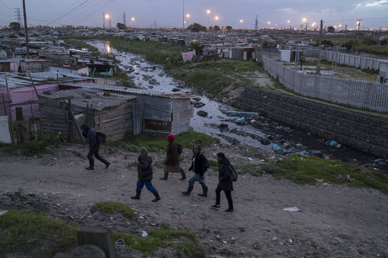South Africans on their way to work in Khayelitsha, a township some 15 miles outside Cape Town, Aug. 24, 2017. The African National Congress built empires of new housing for black South Africans, but concentrated it in the townships, reinforcing the geographic strictures of apartheid; commuting to work in Cape Town costs many residents dearly. (Jo�o Silva/The New York Times) ORG XMIT: XNYT63