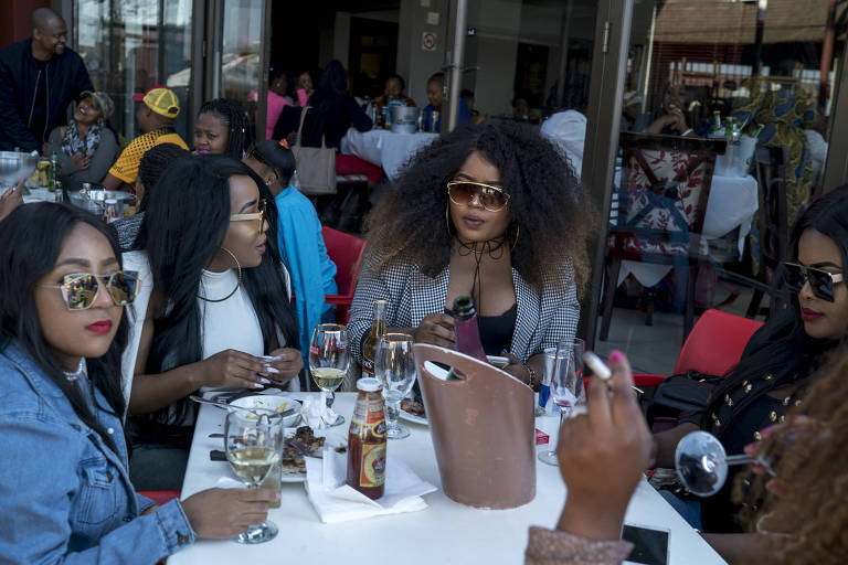 Women dine at Next Door, a pub on Vilakazi Street, in Soweto, South Africa, Aug. 9, 2017. Once a rutted dirt track in the days when Nelson Mandela lived there, today Vilakazi is a lively testament to South Africa�s black middle class � and an example of how the country remains a land of astonishing contrasts. (Jo�o Silva/The New York Times) ORG XMIT: XNYT65