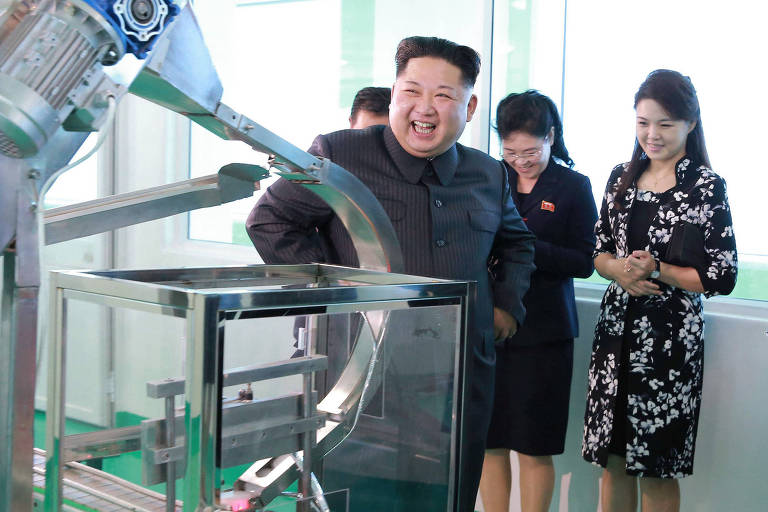 In this undated photo provided Sunday, Oct. 29, 2017, by the North Korean government, North Korean leader Kim Jong Un, center, visits a cosmetics factory in Pyongyang, North Korea. At second from right is Kim's wife Ri Sol Ju. Independent journalists were not given access to cover the event depicted in this image distributed by the North Korean government. The content of this image is as provided and cannot be independently verified. (Korean Central News Agency/Korea News Service via AP) ORG XMIT: TOK802