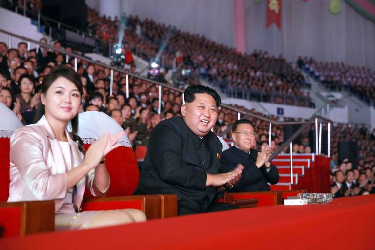 "This undated file picture released by North Korea's official Korean Central News Agency (KCNA) on October 19, 2015 shows North Korean leader Kim Jong-Un (C), accompanied by his wife Ri Sol-Ju (L), enjoying a joint performance by the state merited chorus and the Moranbong band for celebrating the 70th founding anniversary of the Workers' Party of Korea (WPK) at the Ryugyong Chung Ju-yung gymnasium in Pyongyang. North Korean leader Kim Jong-Un has fathered another child, reports said on August 29, 2017, after his wife dropped out of the public eye for several months. First lady Ri Sol-Ju delivered the couple's third child in February, the Yonhap news agency reported Tuesday, citing South Korean lawmakers who were briefed by the National Intelligence Service. / AFP PHOTO / KCNA VIA KNS / STR / South Korea OUT / REPUBLIC OF KOREA OUT ---EDITORS NOTE--- RESTRICTED TO EDITORIAL USE - MANDATORY CREDIT ""AFP PHOTO/KCNA VIA KNS"" - NO MARKETING NO ADVERTISING CAMPAIGNS - DISTRIBUTED AS A SERVICE TO CLIENTS THIS PICTURE WAS MADE AVAILABLE BY A THIRD PARTY. AFP CAN NOT INDEPENDENTLY VERIFY THE AUTHENTICITY, LOCATION, DATE AND CONTENT OF THIS IMAGE. THIS PHOTO IS DISTRIBUTED EXACTLY AS RECEIVED BY AFP. /"
