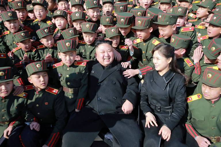 """This file photo from North Korea's official Korean Central News Agency (KCNA) taken on March 2, 2017 and released on March 3, 2017 shows North Korean leader Kim Jong-Un (C) and his wife Ri Sol-Ju (front 2nd R) visiting the Mangyongdae Revolutionary School in Pyongyang. North Korean leader Kim Jong-Un has fathered another child, reports said on August 29, 2017, after his wife dropped out of the public eye for several months. First lady Ri Sol-Ju delivered the couple's third child in February, the Yonhap news agency reported Tuesday, citing South Korean lawmakers who were briefed by the National Intelligence Service. / AFP PHOTO / KCNA VIA KNS / STR / South Korea OUT / REPUBLIC OF KOREA OUT ---EDITORS NOTE--- RESTRICTED TO EDITORIAL USE - MANDATORY CREDIT """"AFP PHOTO/KCNA VIA KNS"""" - NO MARKETING NO ADVERTISING CAMPAIGNS - DISTRIBUTED AS A SERVICE TO CLIENTS THIS PICTURE WAS MADE AVAILABLE BY A THIRD PARTY. AFP CAN NOT INDEPENDENTLY VERIFY THE AUTHENTICITY, LOCATION, DATE AND CONTENT OF THIS IMAGE. THIS PHOTO IS DISTRIBUTED EXACTLY AS RECEIVED BY AFP. /"""