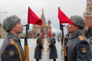 Russian Army members take part in a rehearsal for a military parade at the Red Square in Moscow