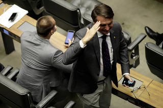 Federal Deputy Bolsonaro gestures during a session of the chamber of deputies in Brasilia
