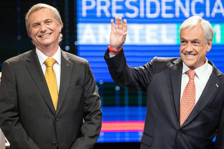 O direitista Jos� Antonio Kast (� esq.) aparece ao lado do ex-presidente Sebasti�n Pi�era em debate