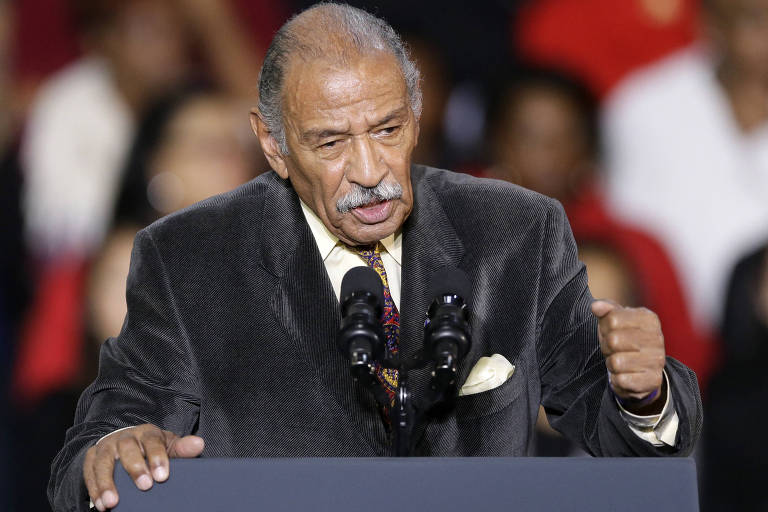 FILE - In this Nov. 1, 2014, file photo, Rep. John Conyers, D-Mich., speaks at Wayne State University in Detroit. Democrats have been quick to support the ?me too? chorus of women _ and some men _ who have stepped up to allege sexual misconduct and name names. But now ?me too? stains the Democrats, too, putting them in an awkward place as they calibrate how forcefully to respond. (AP Photo/Carlos Osorio, File) ORG XMIT: WX107